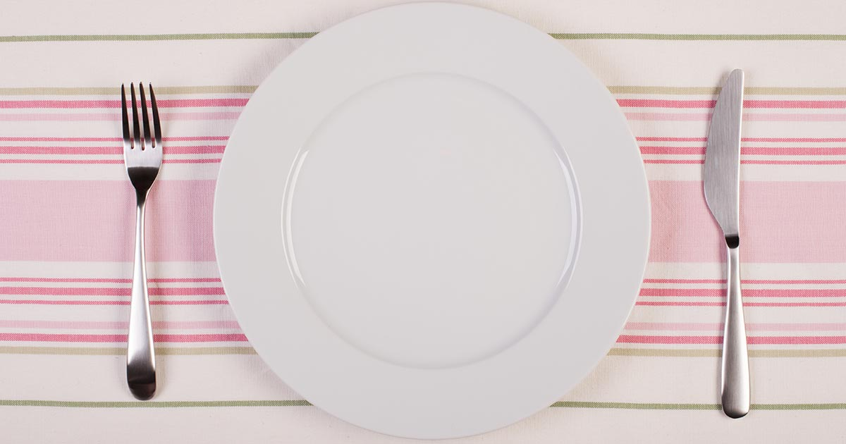 A clean plate with utensils