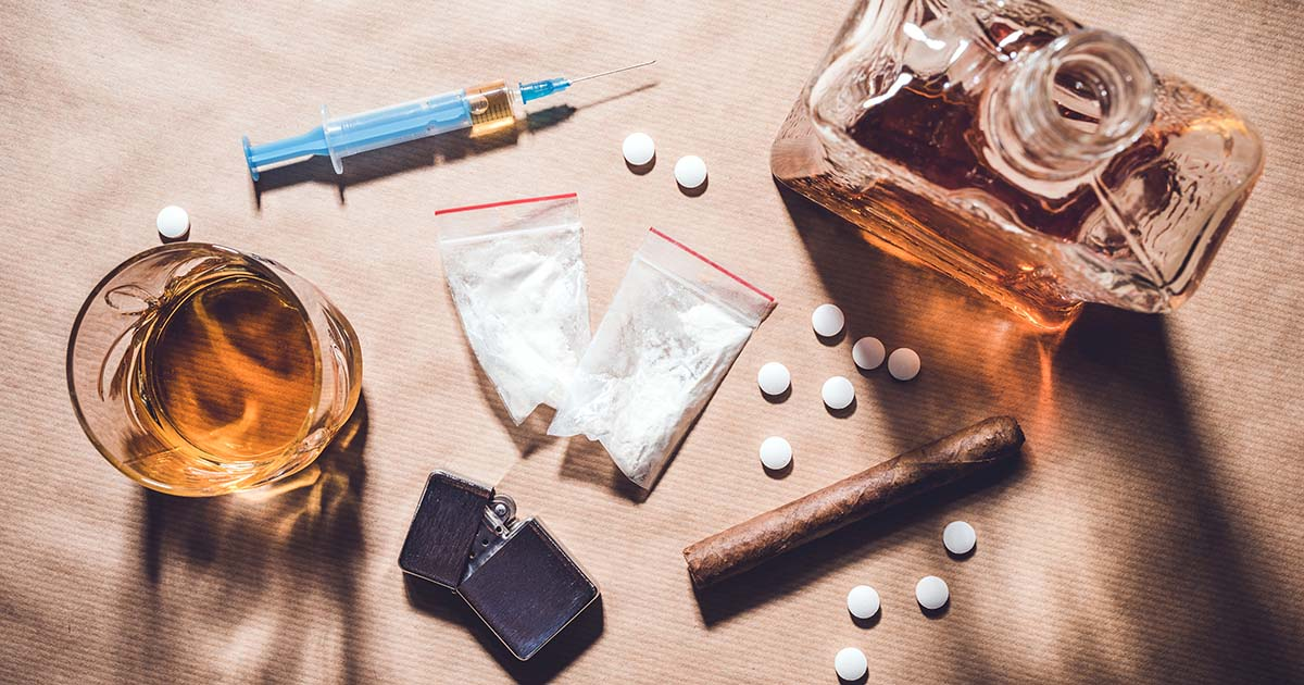 Top view of hard drugs and alcohol